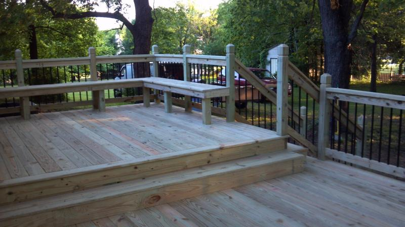 Deck with built in bench and step down alluminum ballasters treated lumber