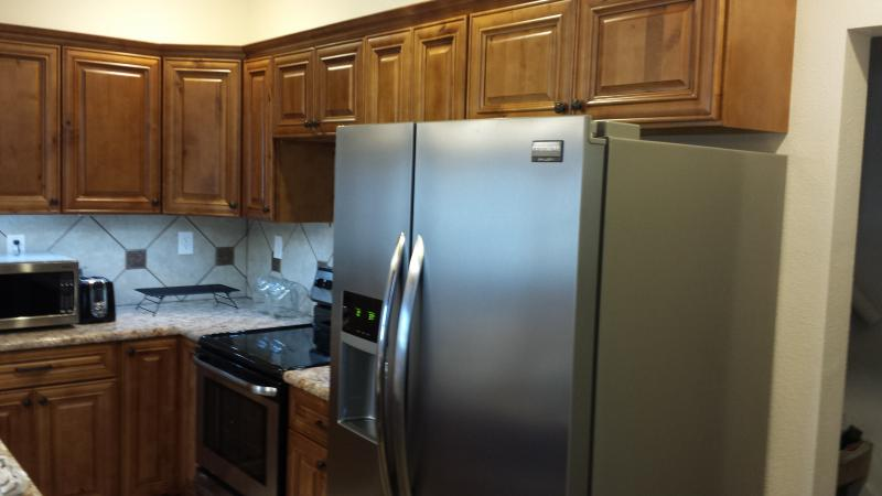 knotty maple cabinets stainless steel refrigerator with Ice and water in door
